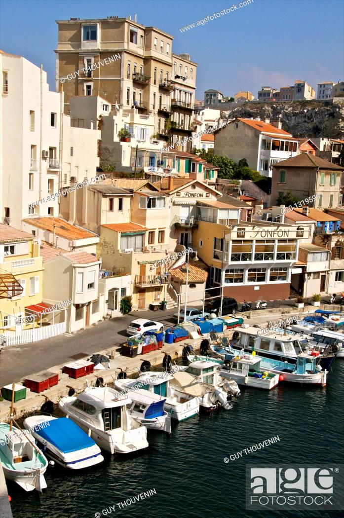Stock Photo: Small homes and high building, typical harbour of the Vallon des Auffes, coast road/corniche, Marseille, Bouches du Rhone, 13, France.
