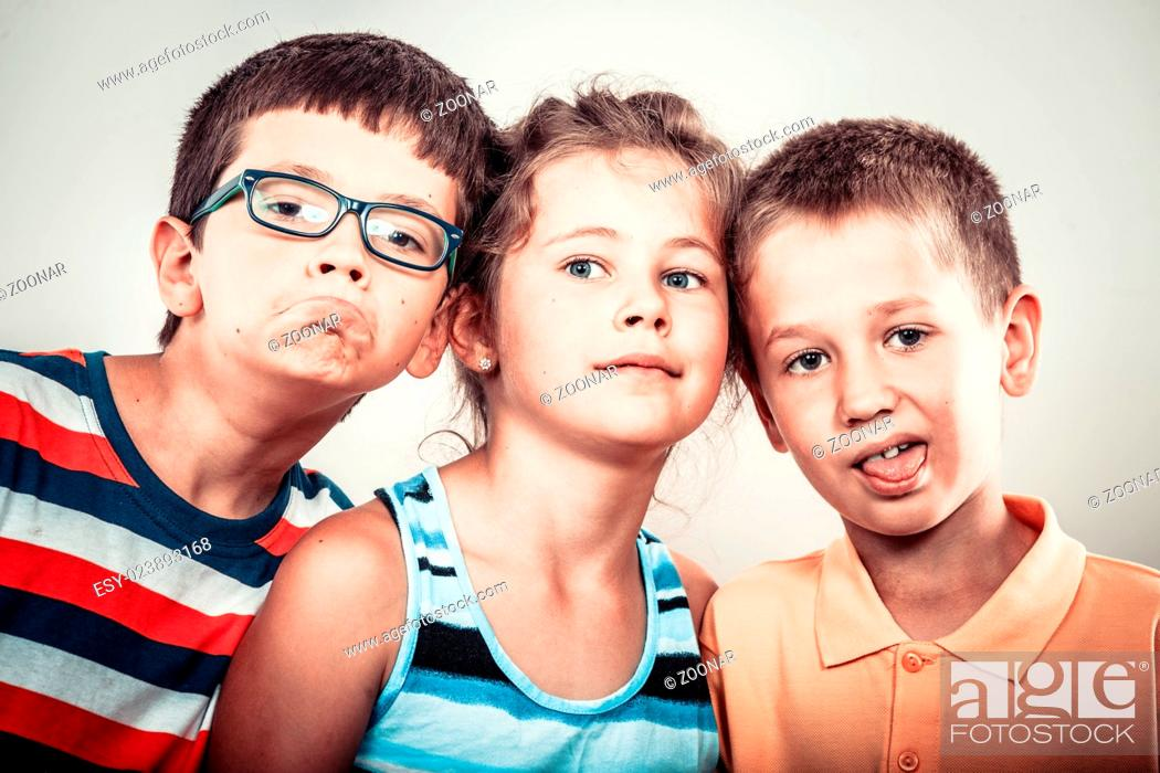 Stock Photo: Kids little girl and boys making silly face expression.