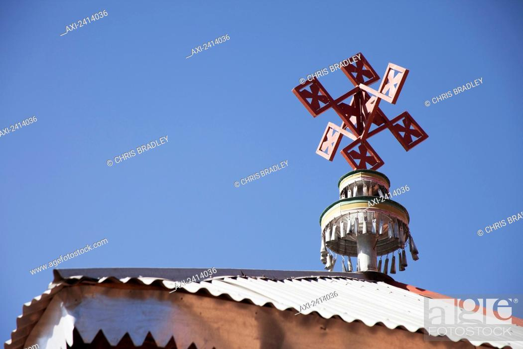 Cross on top of modern church building, beside Abreha wa Atsbeha