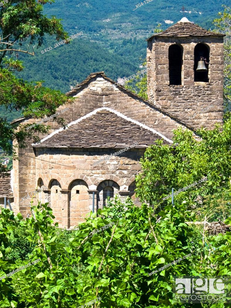 Stock Photo: Tower and apse of the Romanesque church of Santa Eulalia in Orós Low - Biescas - Serrablo - Alto Gallego - Province of Huesca - Aragón - Aragonese Pyrenees.