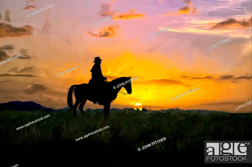 Stock Photo: Montana cowboy on the range at first light.