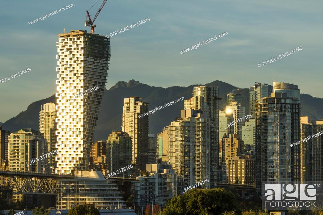 Stock Photo: Skyline at twilight, with Vancouver House tower on left, Vancouver, BC, Canada.