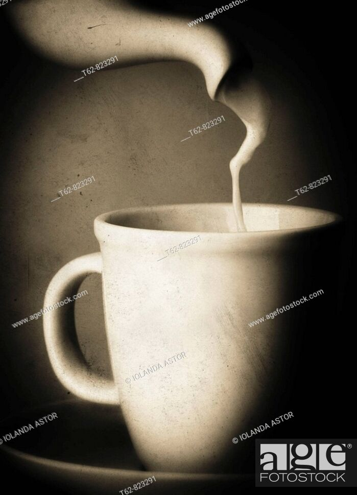 Stock Photo: Serving milk in the cup.