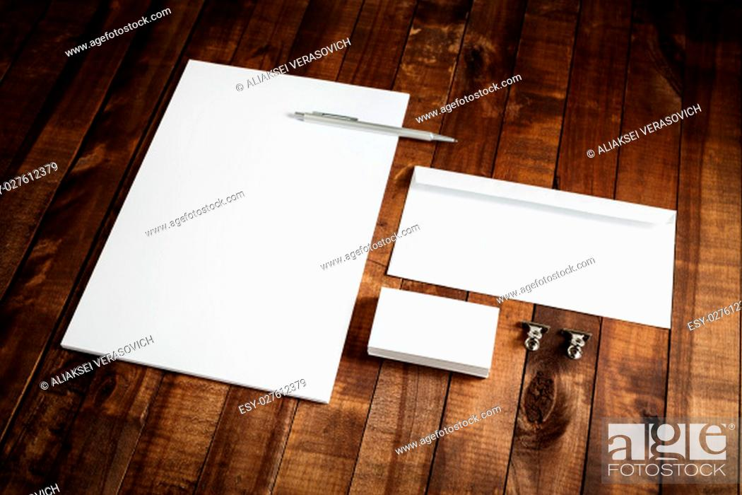 Stock Photo: Photo of blank stationery set on wooden table background. Blank letterhead, business cards, envelope and pen. Mock up for branding identity.