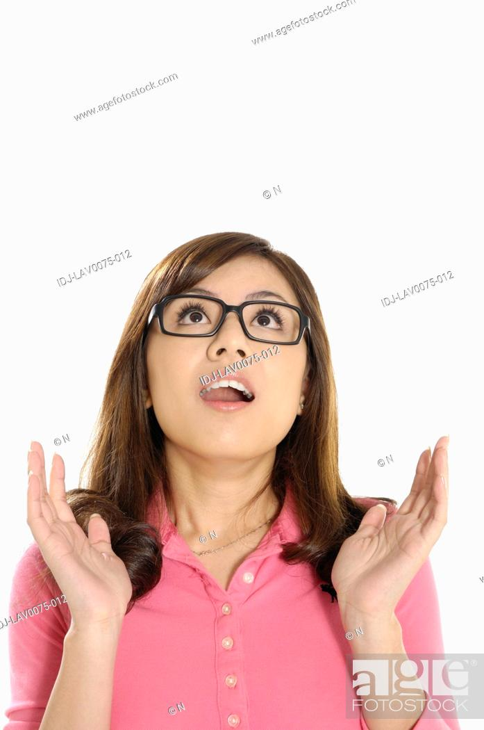 Stock Photo: Female university student looking surprised.
