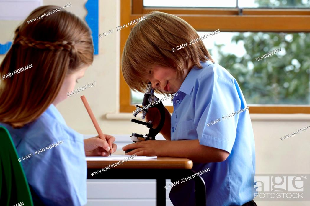 Stock Photo: School children working on an assignment in classroom.