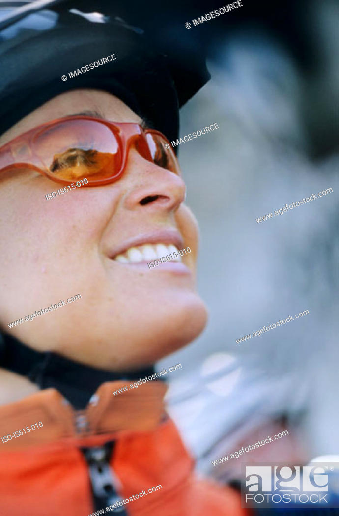 Stock Photo: Smiling female cyclist.