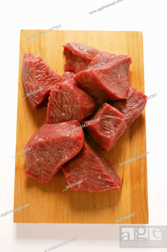 Stock Photo: Diced beef on chopping board.