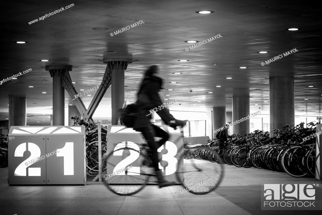 Stock Photo: 21 - 23, bike looking for parking space in Gent-Sint-Pieters, Belgium.