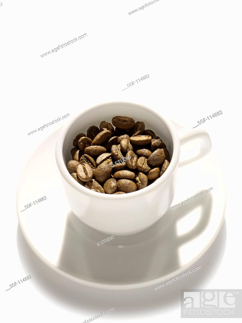 Stock Photo: Coffee beans in a coffee cup.