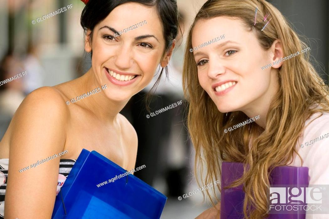 Stock Photo: Close-up of female university students smiling.