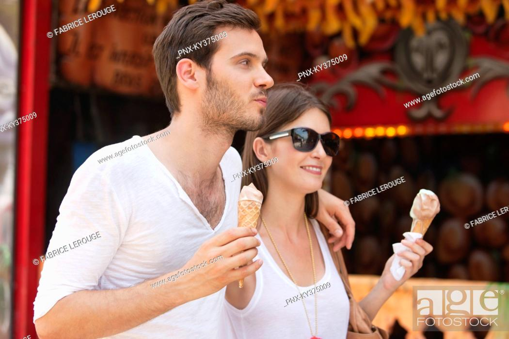 Stock Photo: Couple eating ice creams, Paris, Ile-de-France, France.