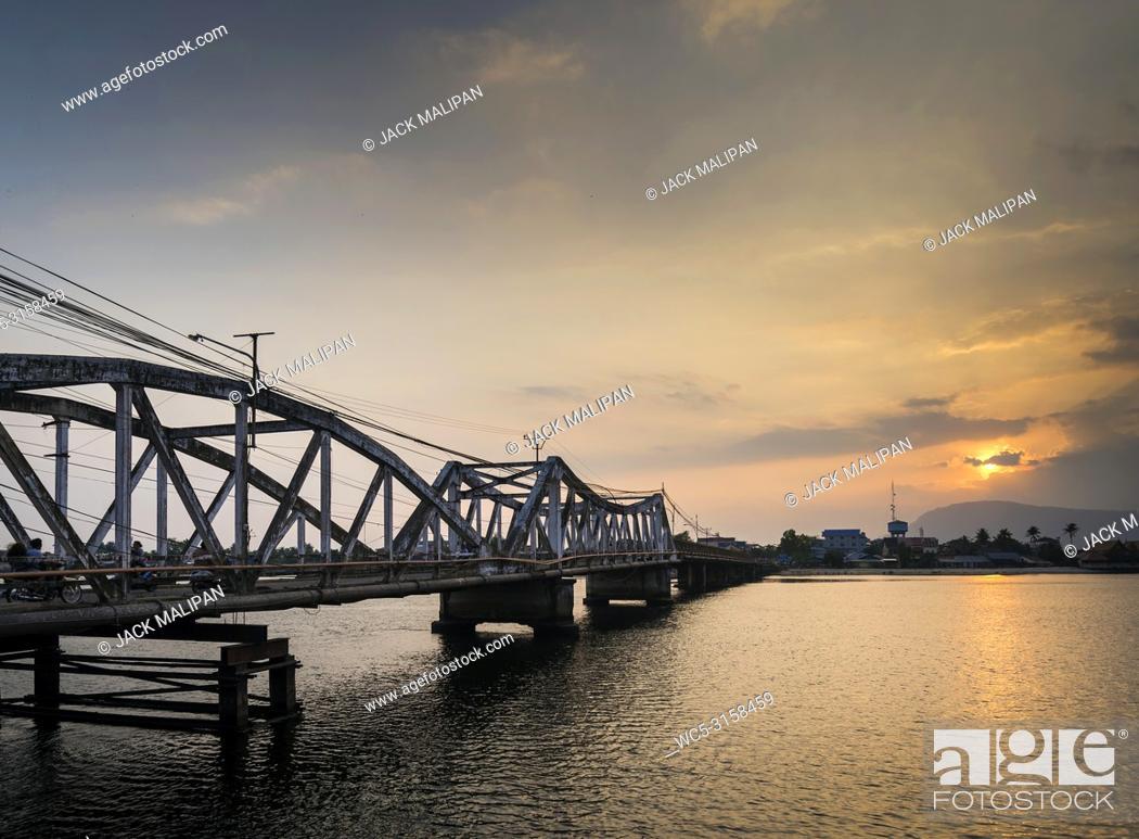 Stock Photo: landmark old bridge and river at sunset in kampot cambodia.