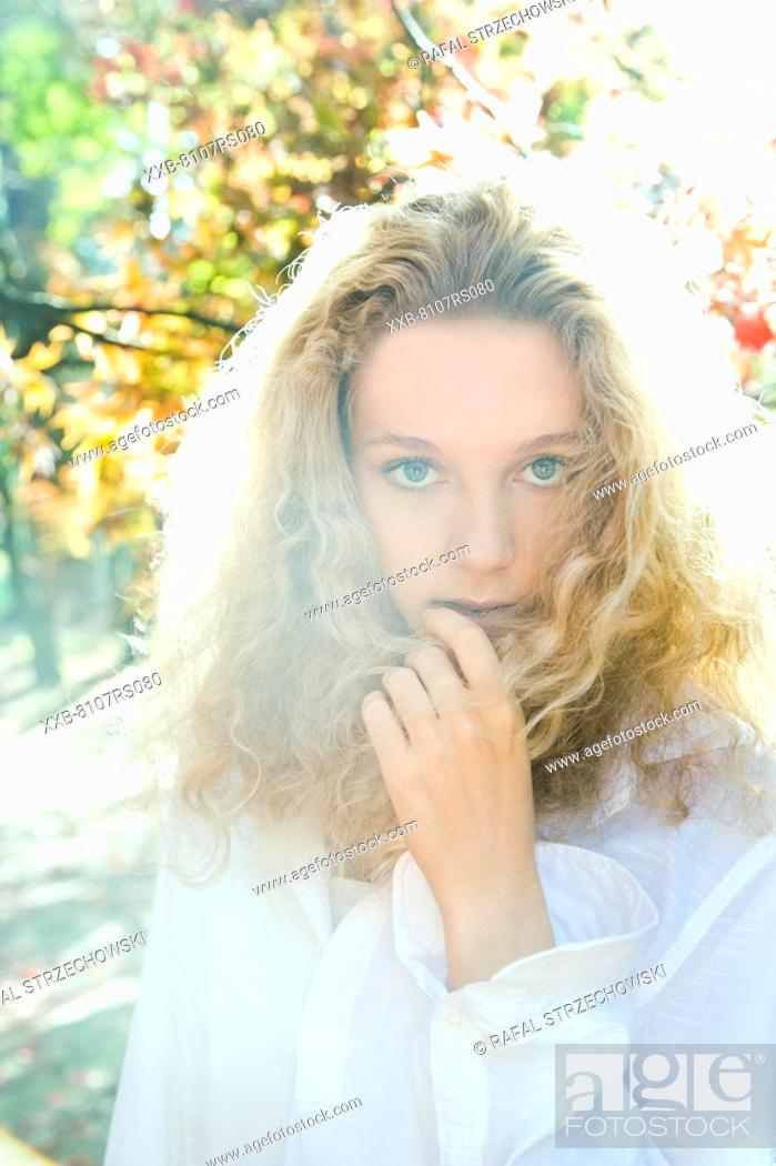 Stock Photo: Autumn portrait of woman in white shirt.