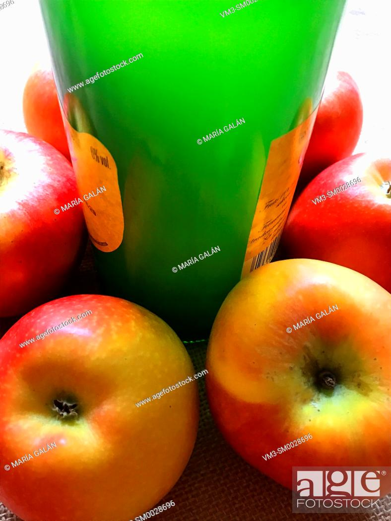 Stock Photo: Cider bottle with apples. Asturias, Spain.