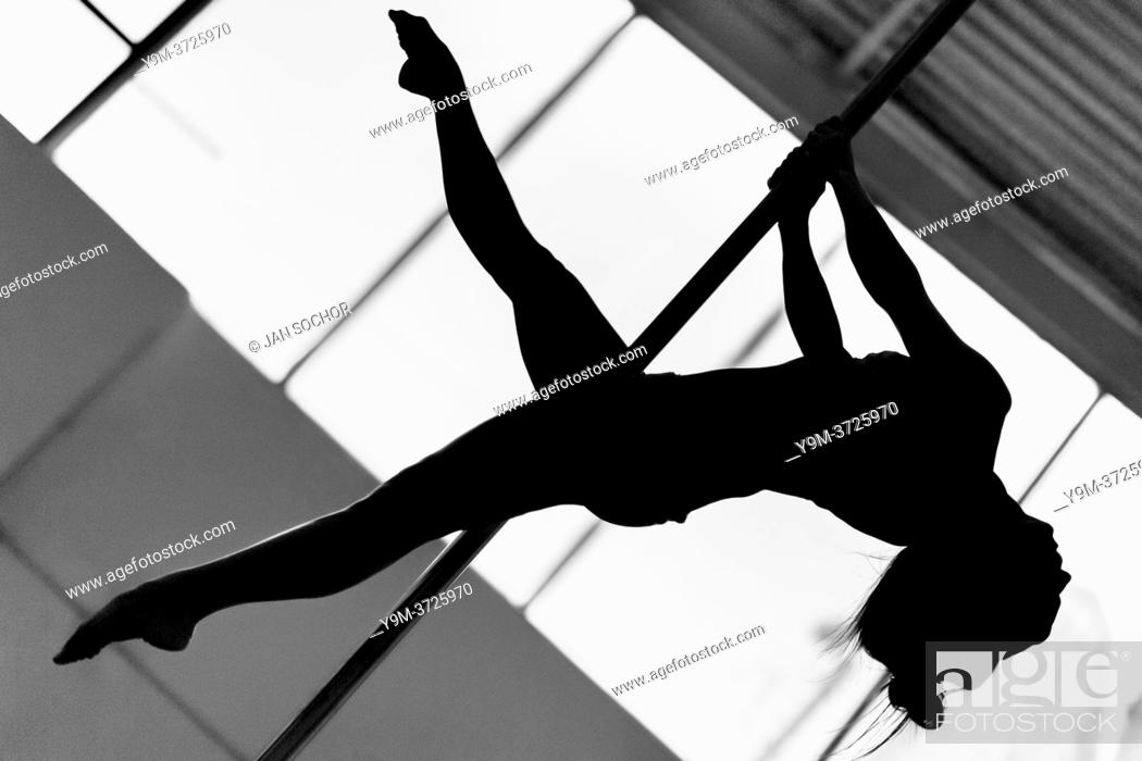 Stock Photo: A young Colombian pole dancer performs a dance routine during a pole dance training session in a gym in Bogotá, Colombia, 24 October 2019.