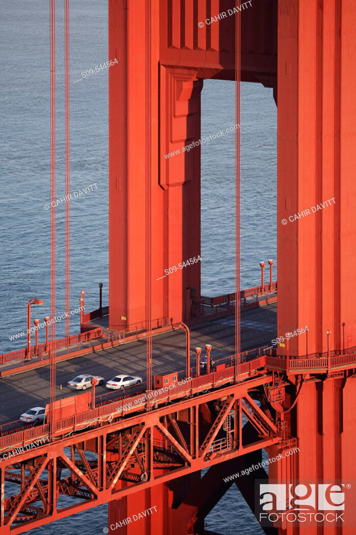 Stock Photo: Detail of the bridge deck and tower of the Golden Gate Bridge, San Francisco, California, United States of America.
