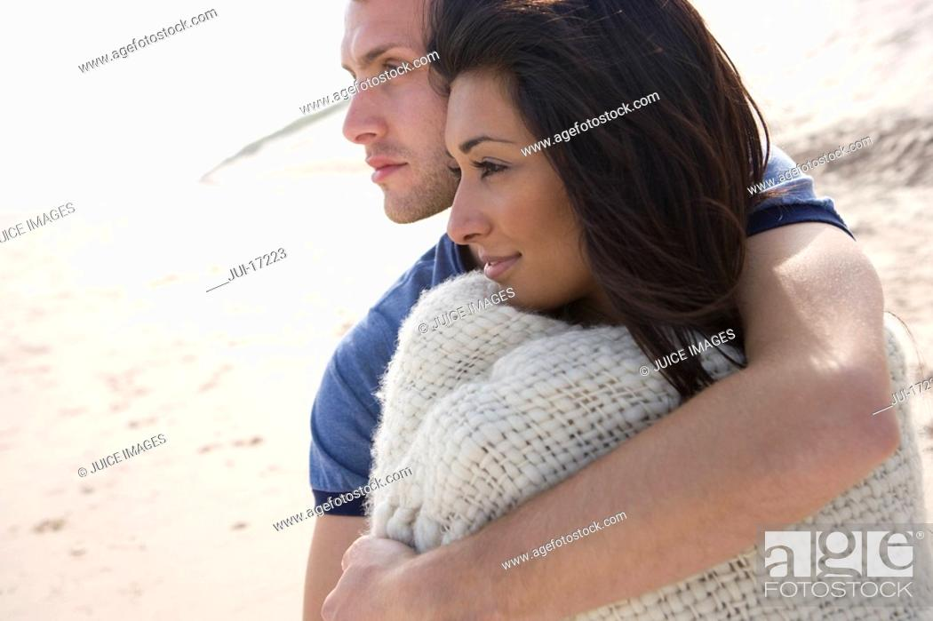 Stock Photo: Young couple hugging at beach.