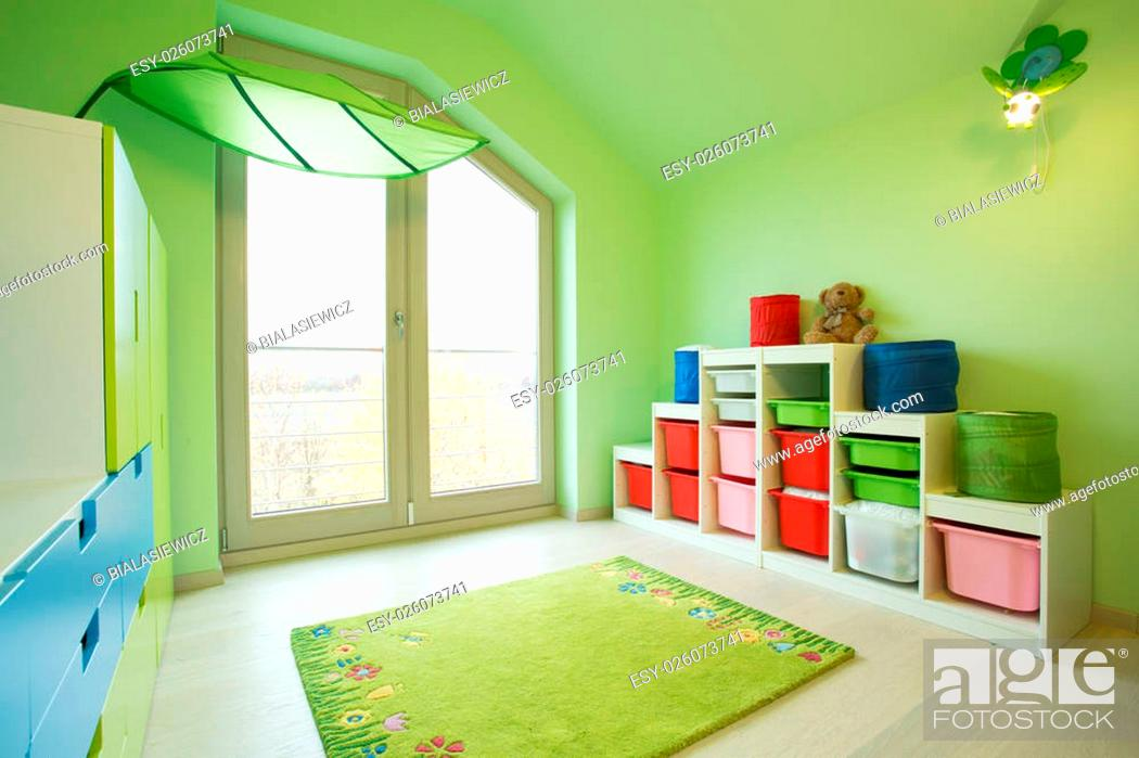 Stock Photo: View of children room with green walls.