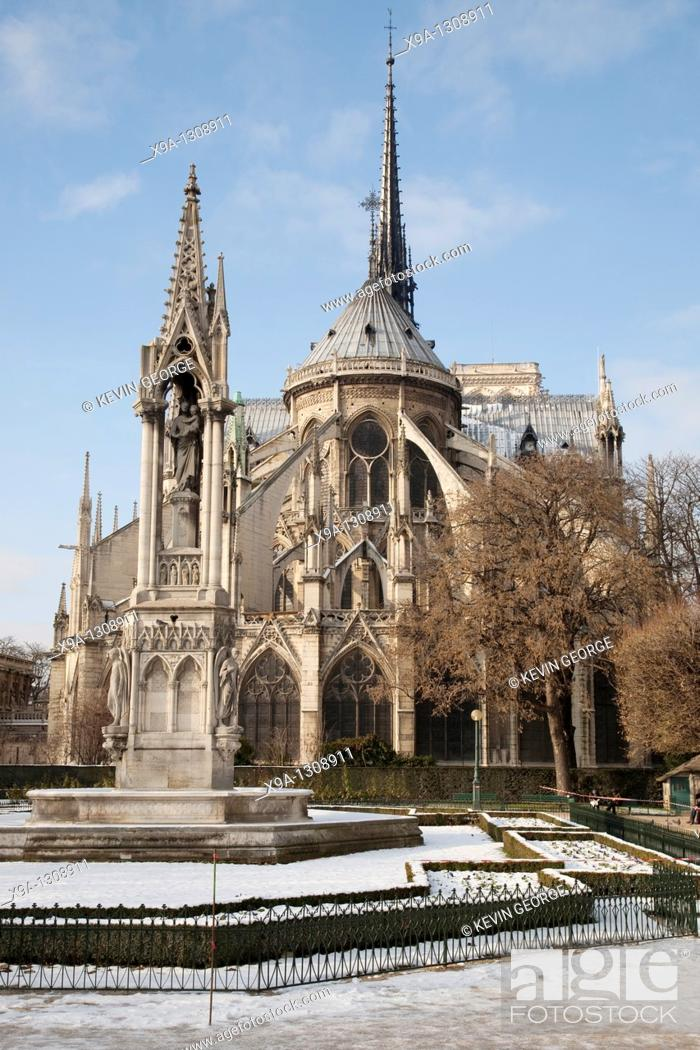 Stock Photo: Notre Dame Cathedral Church in the Snow in Winter in Paris, France.