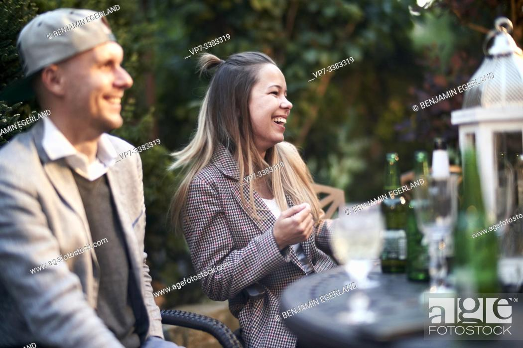 Stock Photo: middle-aged friends enjoying garden party.