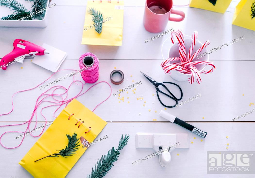 Stock Photo: Over view making Holiday decor and advent calendar sewing paper bags.
