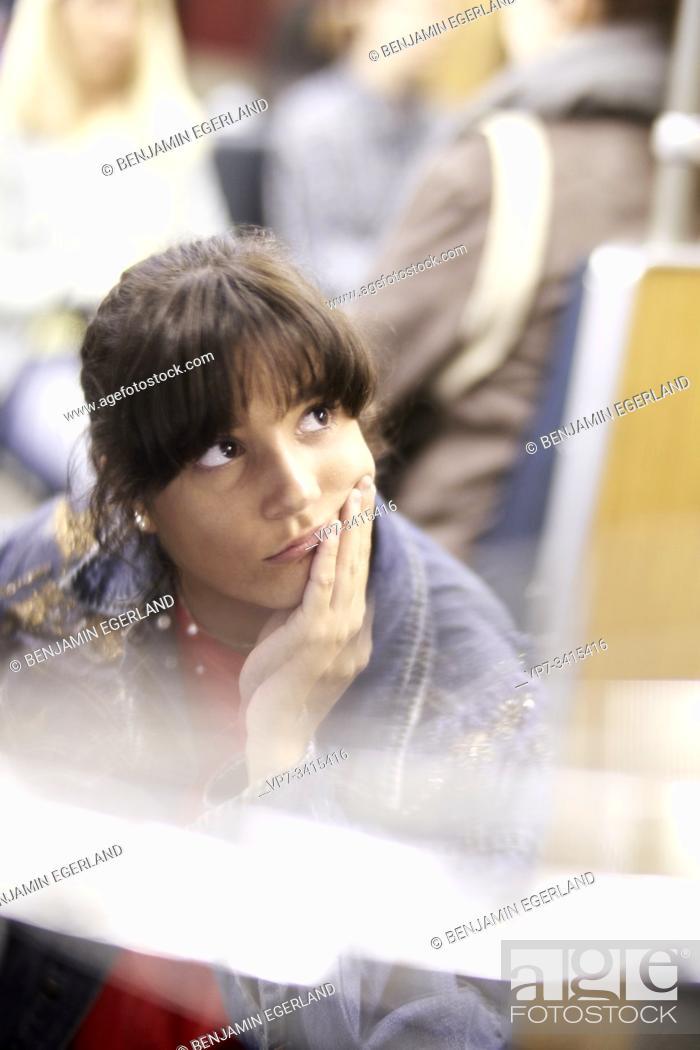 Stock Photo: Woman in subway, Munich, Germany.