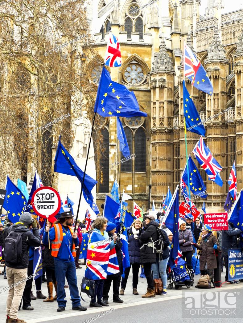 Stock Photo: London 15 January 2019 - Leave and Remain supporters gather outside Parliament ahead of the crucial Brexit vote - London, England.