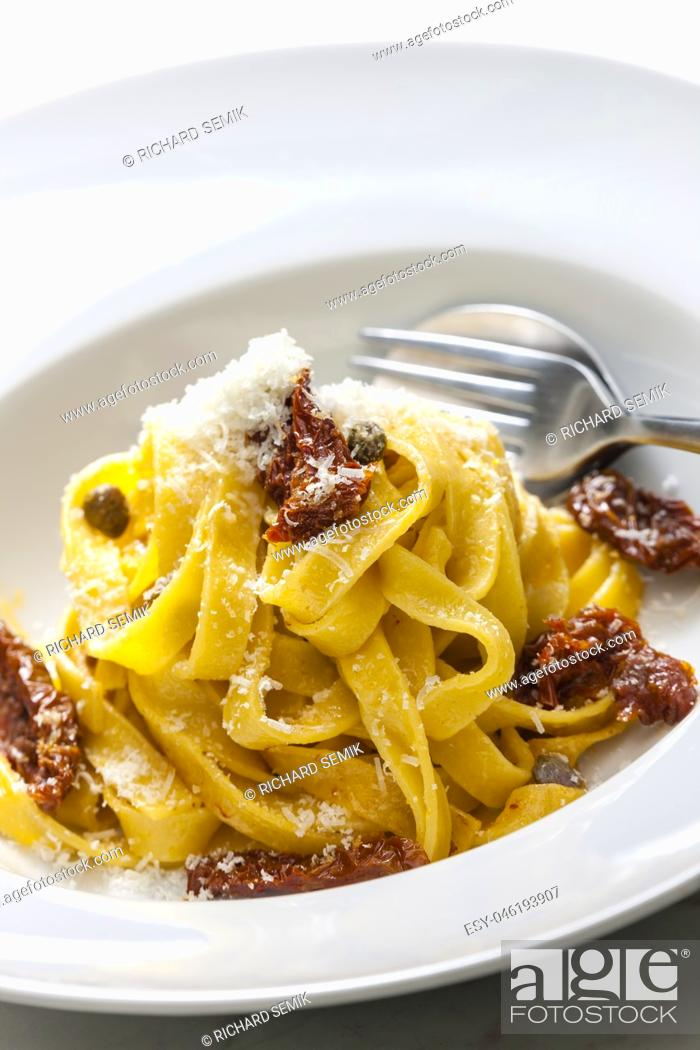 Photo de stock: pasta with dried tomatoes.