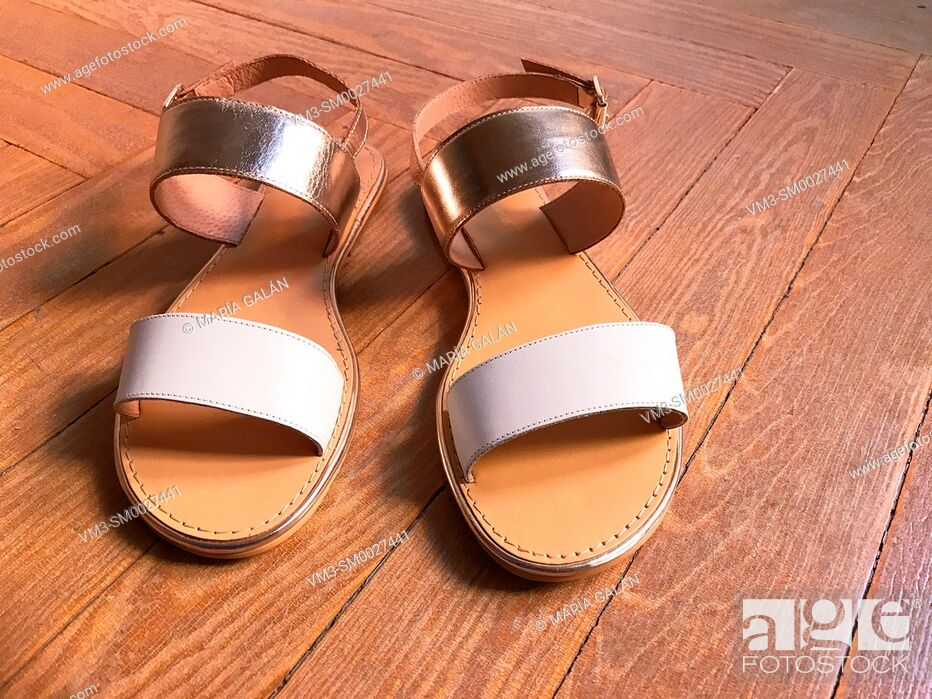 Stock Photo: Leather sandals on wooden floor.