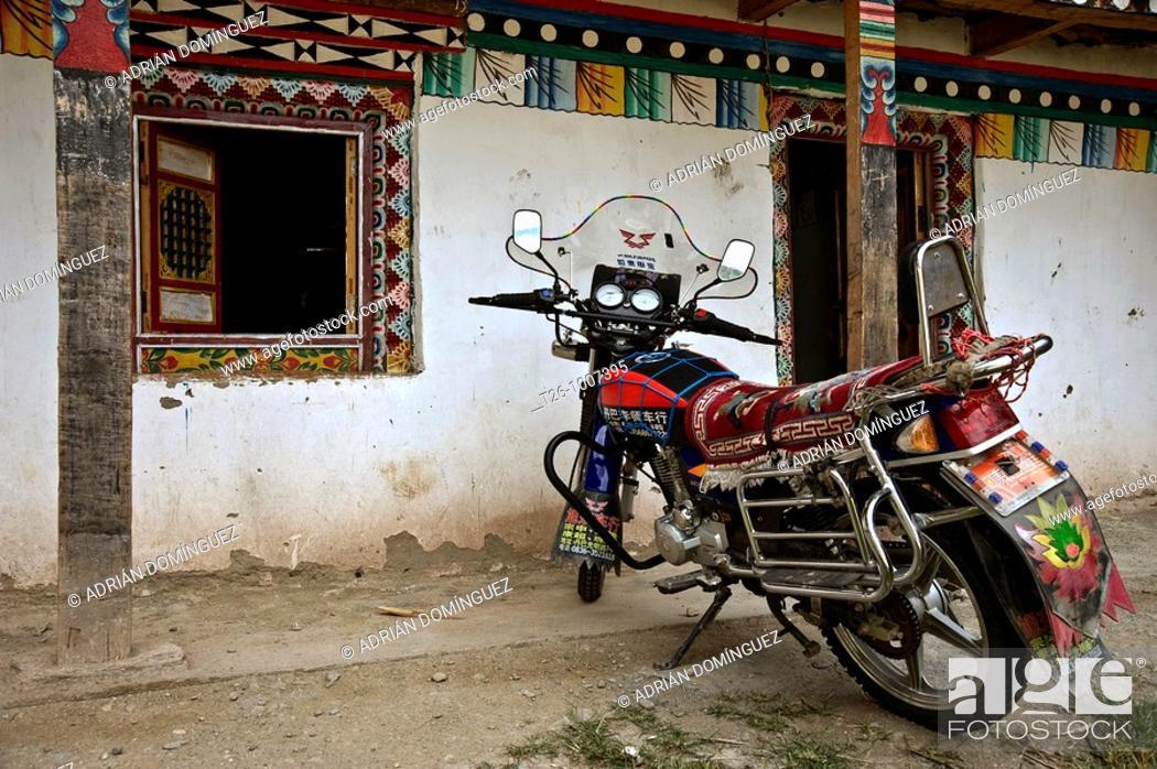 Stock Photo: Motorbike in a Buddhist Temple in Damba, China.