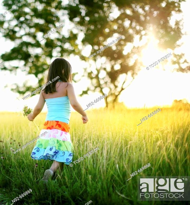 Stock Photo: Girl, age 5, summer flower picking,.
