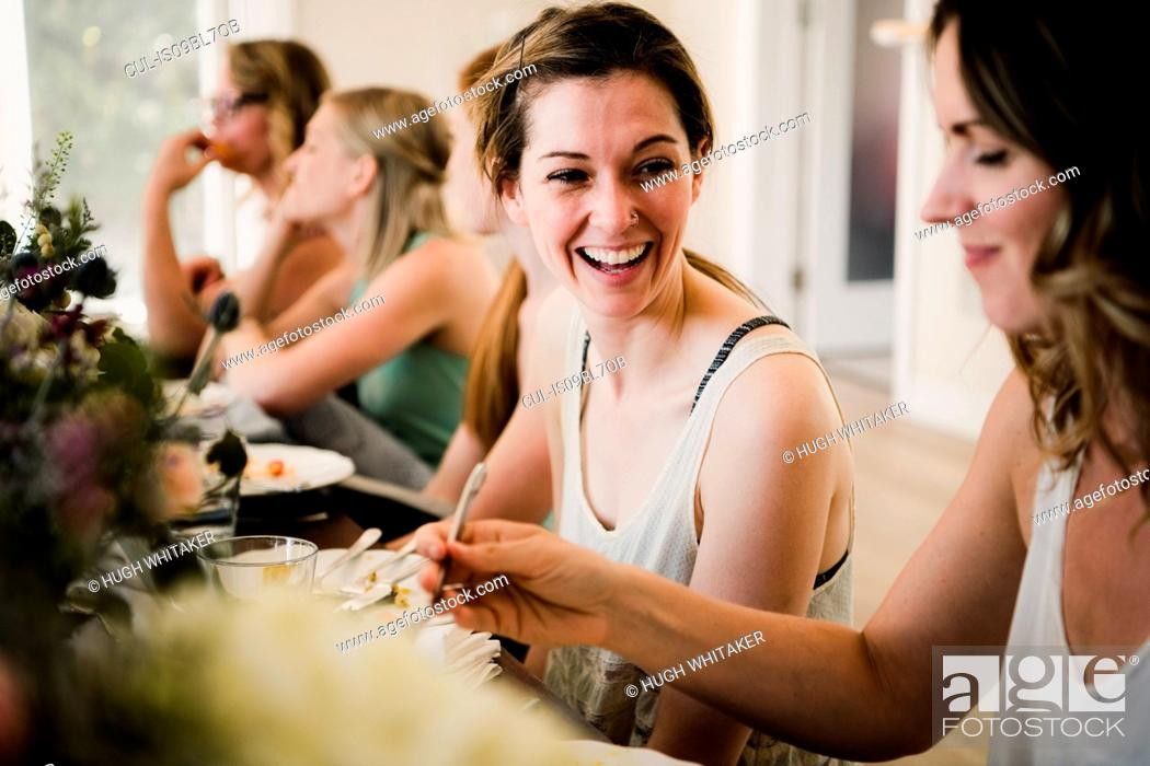 Stock Photo: Women enjoying friendship and meal in yoga retreat.