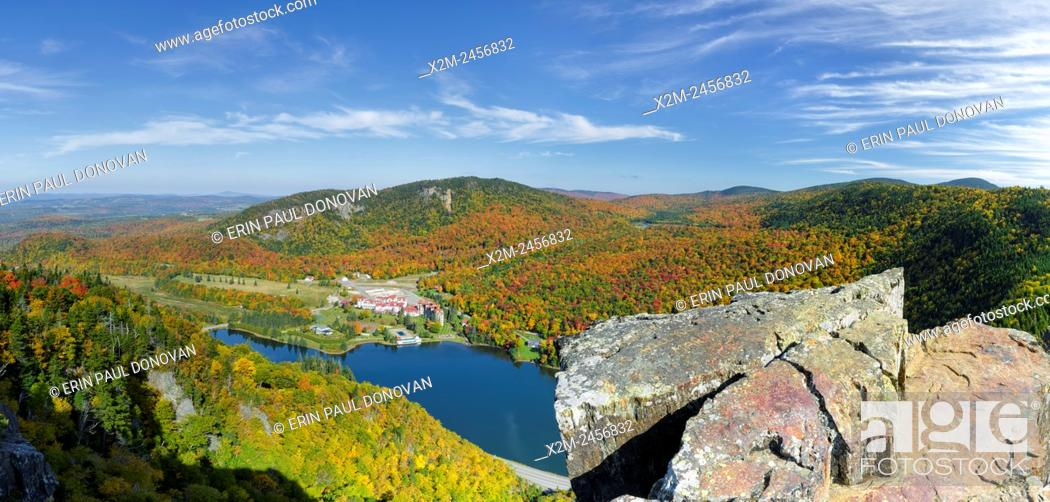 Stock Photo: Dixville Notch - Panoramic of Lake Gloriette in Dixville, New Hampshire USA from Table Rock during the autumn months. The Balsams Grand Resort is in view.