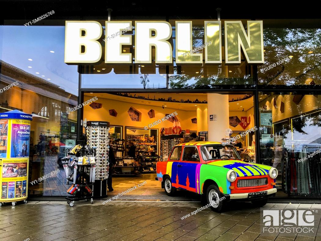 Stock Photo: Berlin, Germany. Colorfull commercial Trabi inside a shop's enterance at Karl Liebknecht Strasse.
