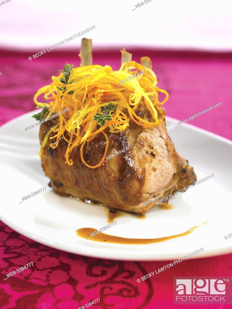 Stock Photo: costillar de cordero con citricos / rack of lamb with citrus.
