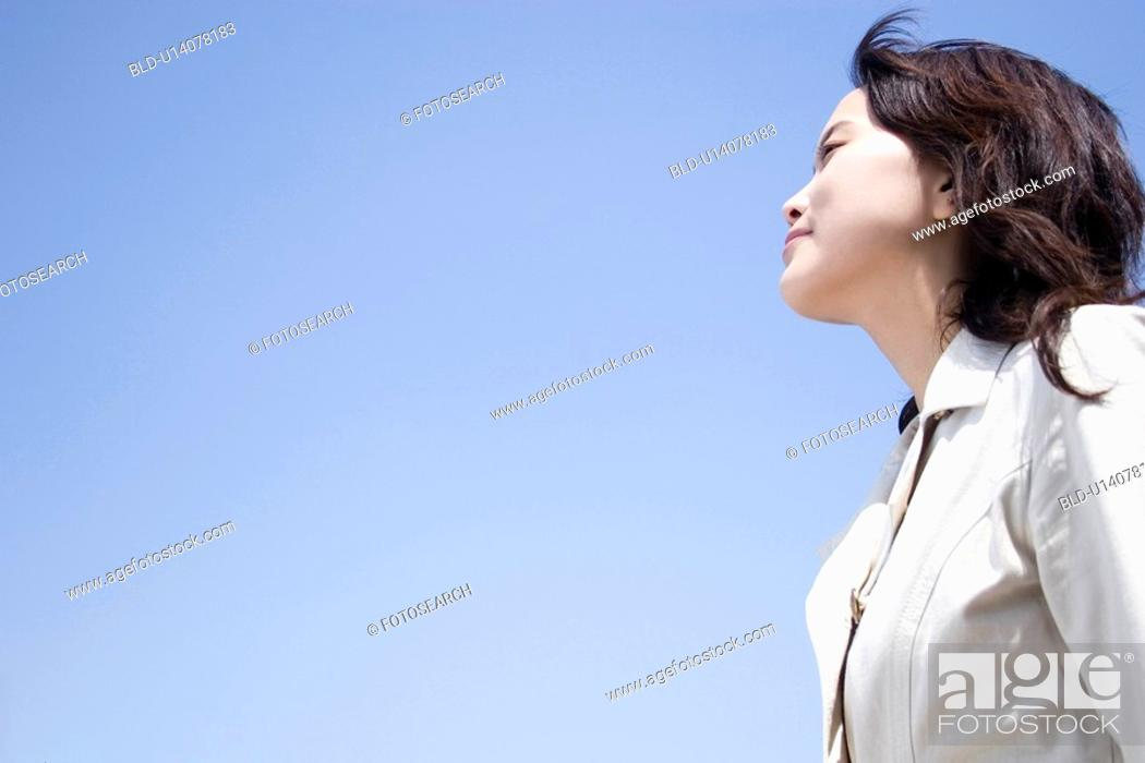 Stock Photo: Sky and woman.