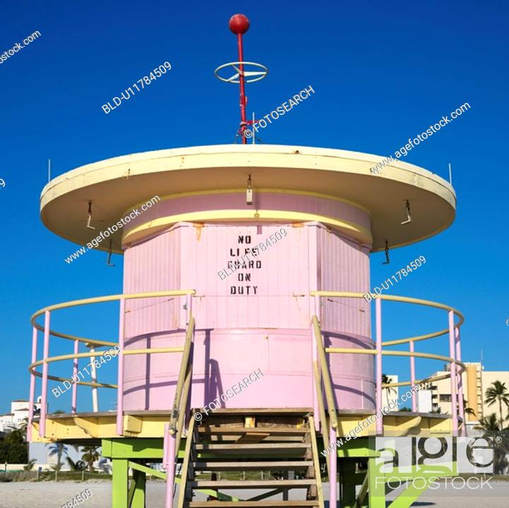 Stock Photo: Pink art deco lifeguard tower closed up on beach in Miami, Florida, USA.