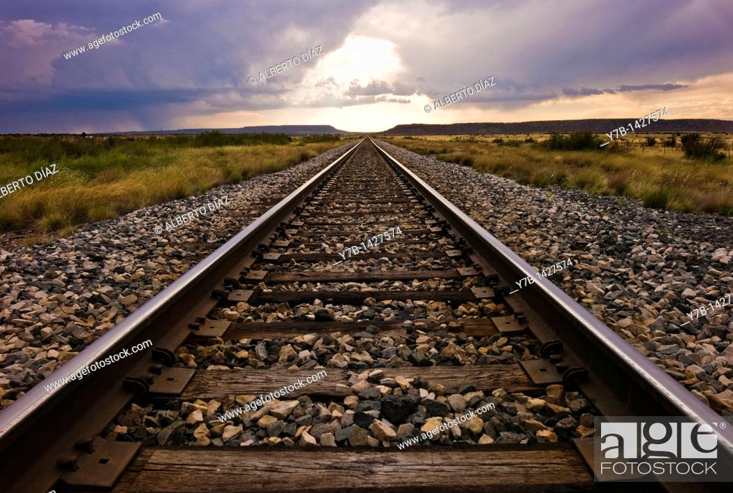 Stock Photo: Railroad track parallel to New Mexico Route 66.