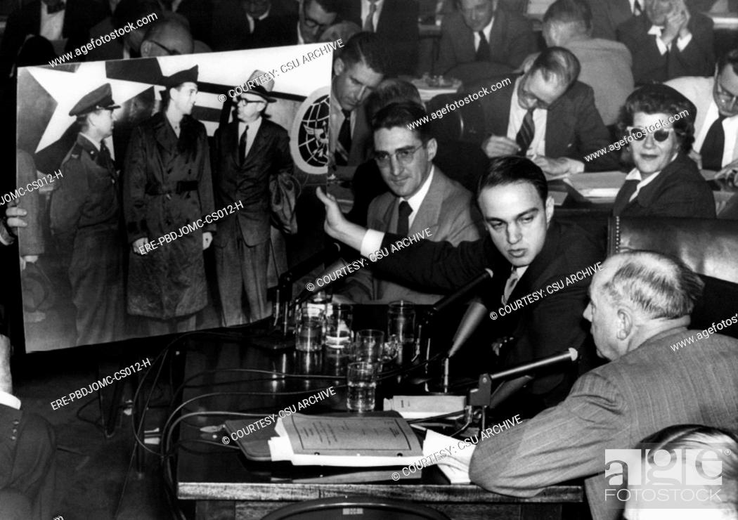 Roy Cohn center, Senator Joseph McCarthy's attorney during