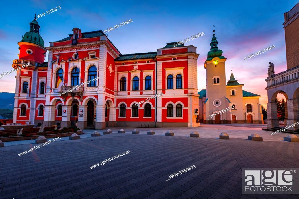 Stock Photo: Ruzomberok, Slovakia - April 26, 2019: Town hall and a church in the main square of Ruzomberok.