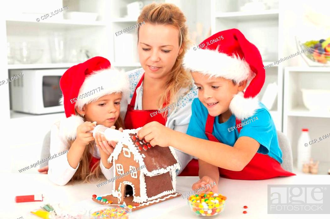 Stock Photo: Happy family at christmas time in the kitchen.