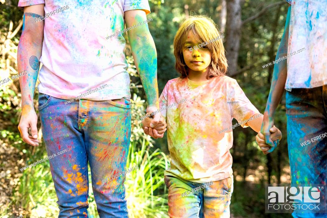 Stock Photo: Family in the forest, full of colorful powder paing, after celebrating Holi, Festival of colors.