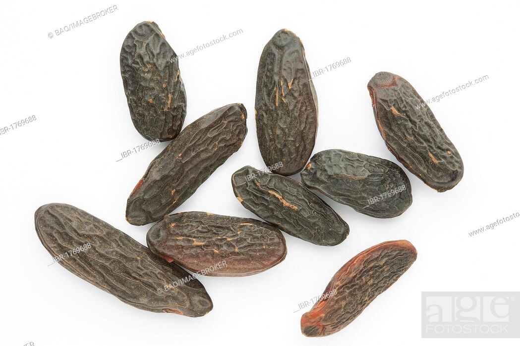 Stock Photo: Tonka beans, seed of the Tonka tree (Dipteryx odorata), spice and flavoring.