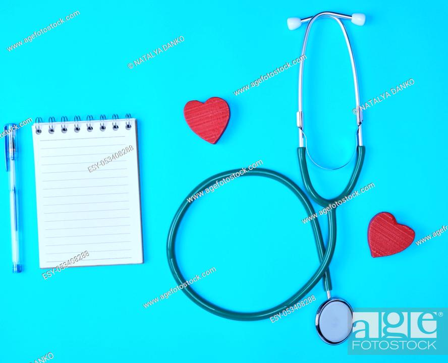 Stock Photo: paper in a line and a medical stethoscope on a blue background.