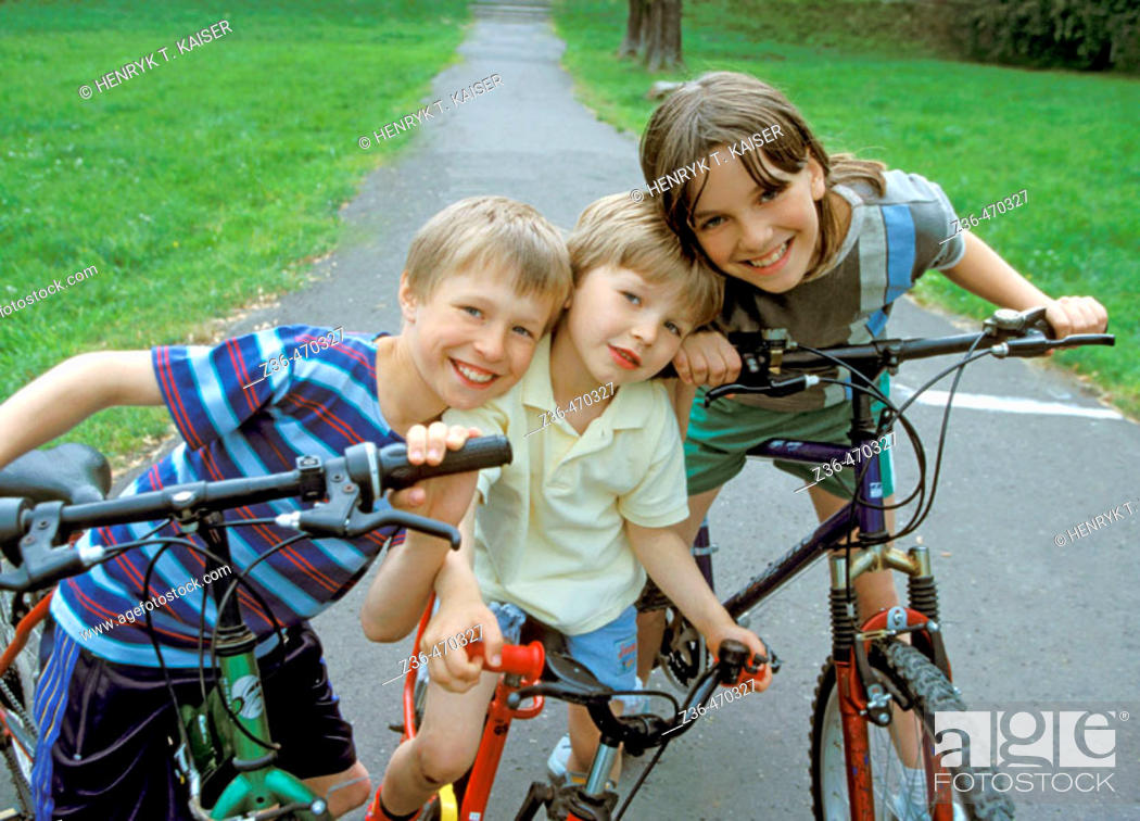 Stock Photo: Children riding bicycles together.