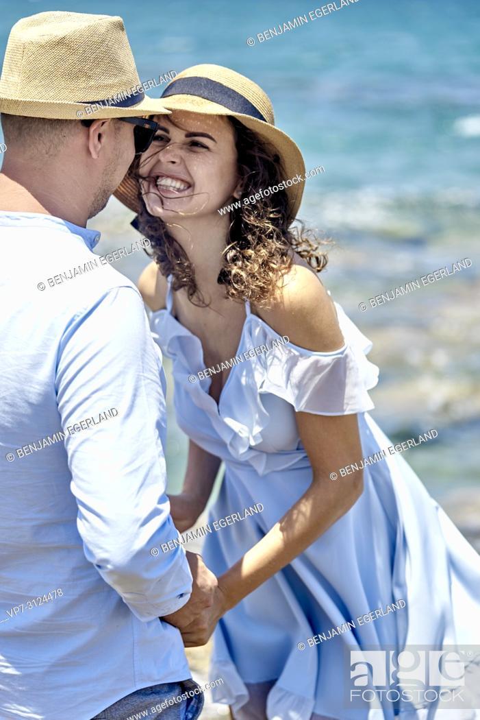 Stock Photo: vital woman smiling at boyfriend, couple, love, holidays.