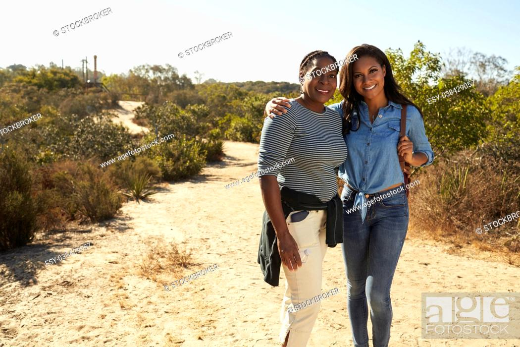 Stock Photo: Portrait Of Mother And Adult Daughter Hiking In Countryside.