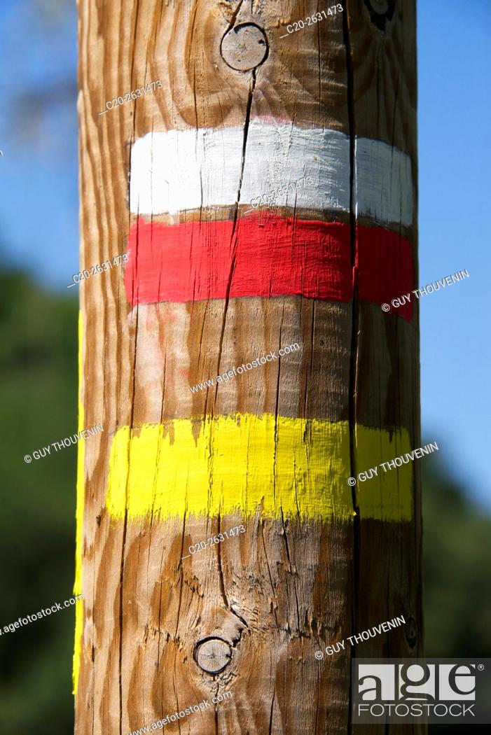 Stock Photo: Pedestrian paint marks on wooden post, for hikers, 43, Auvergne, Haute Loire, France.