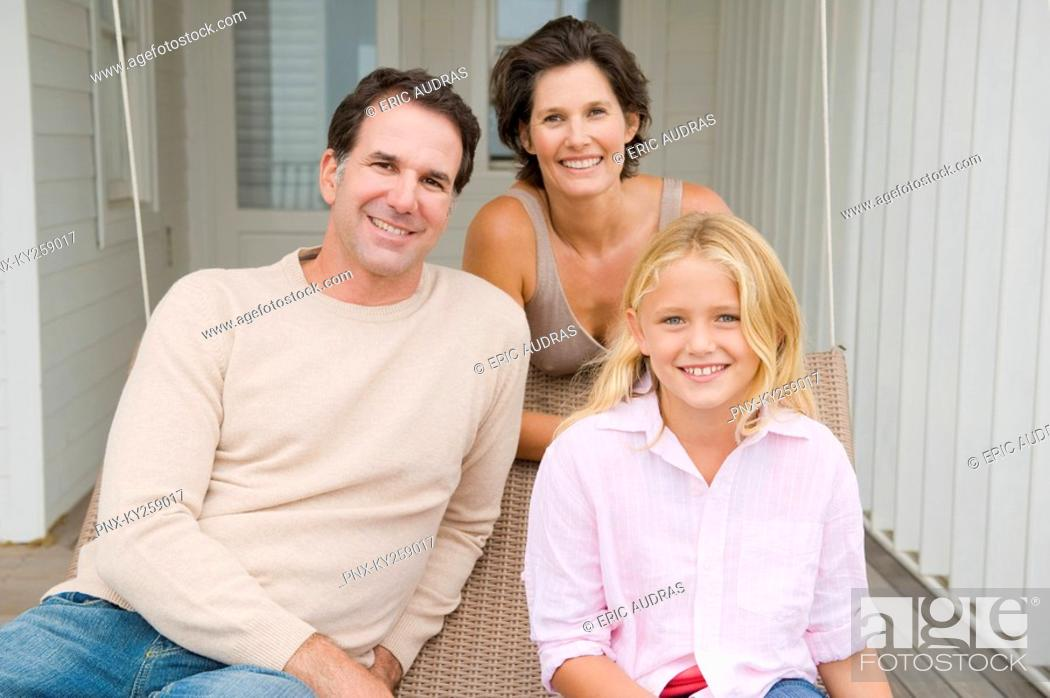 Stock Photo: Couple smiling with their daughter.